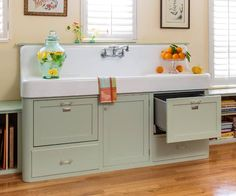 A custom cabinet, with rounded corners to match the vintage apron sink, holds two dishwasher drawers installed at either end. Sink: Ohmega Salvage, Berkeley, CA; 510-843-7368. Dishwasher drawers: Fisher & Paykel. Faucet: chicagofaucets.com   Photo: Mark Lohman   thisoldhouse.com