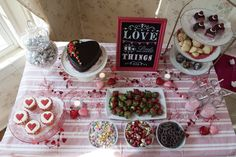 Valentine's Day Dessert Table Display; Cakes, Candies, Cupcakes, Chocolate-covered strawberries