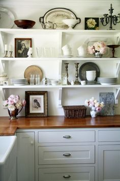 lots of old stuff on shelves makes me happy. <<< a kitchen with only the bare essentials.. something romantic about this...