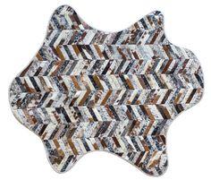 Amoeba shaped Mr Crowley rug shown in various naturals #cowhide
