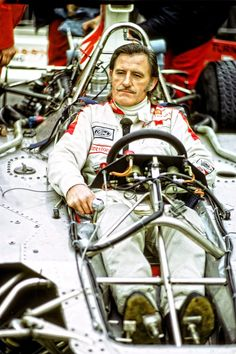 Graham Hill in a 70s F1 car with the body panels removed