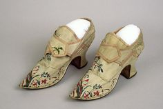 Pair of woman's shoes, England, c. 1750. Cream silk brocade with polychrome floral embroidery, pink silk tape; fabric-covered Louis heels and with pointed toes.