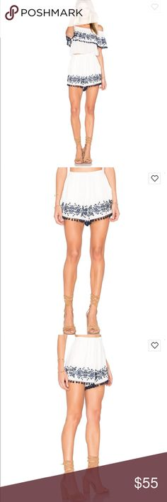 SHOW ME YOUR MUMU Laney Pom Pom Embroidered Shorts e cannot get enough of this Show Me Your Mumu pom tassel shorts!   Fabric Content:  100% Rayon   Care:  Dry Clean Only Show Me Your MuMu Shorts