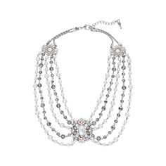 This swag necklace features faceted glass beads, gorgeous cream pearls, and romantic sparkly details.