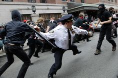 A police lieutenant swings his baton at an Occupy Wall Street activists on May 1 in New York. Activists with a variety of causes spread out over New York City Tuesday on International Workers Day, or May Day, with Occupy Wall Street members leading a charge against financial institutions. (Mary Altaffer/Associated Press) #