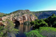 """the Lake of Vouliagmeni,a natural lake fed by underground caves and with a year-round temperature of 25C, well known for its therapeutic properties in the treatment of arthritis, rheumatism,gynecological ailments and neuralgia.It took its name from the Lake and the word Vouliagmeni means """"sunken area""""."""