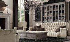 Rooms | Restoration Hardware - the tufted sofa is OK, but I'm more a fan of classic chesterfields - I love the orb chandelier, the proportion of the room with the cabinet centered with prints on either side - the tones are fantastic