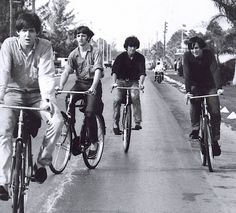 Paul McCartney, Ringo Starr, George Harrison and John Lennon ride bikes.     Help!