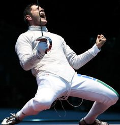 Aldo Montano of Italy rejoices after defeating Aliaksandr Buikevich of Belarus during a quarterfinal match in men's team saber fencing.