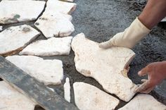 Build a flagstone patio to create a welcoming outdoor living space in your backyard. Here's how to DIY a real flagstone patio in 10 steps. Flagstone Paving, Paver Edging, Paving Stones, Landscape Edging, Landscape Fabric, How To Lay Concrete, Sand And Gravel, Landscaping Supplies, Rock Decor