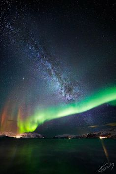 Northern lights, sea and Milkyway