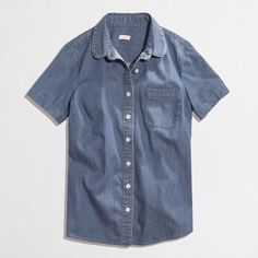 J. Crew Short Sleeve Chambray Button Up J. Crew retail chambray button up with short sleeves. Perfect for layering without the bulk of full length sleeves. All buttons are in fact and two extras are sewn into the inside. Excellent condition. J. Crew Tops Button Down Shirts