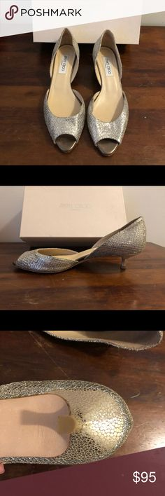 Jimmy Choo Lyon Glitter Kitten Heel size 40 Beautiful Jimmy Choo champagne kitten heels only worn once! Comes with original box from Saks. They have been stored in a pet and smoke free home. Very little signs of wear. There is slight discoloration (pictured) on the side that is not visible when worn. Jimmy Choo Shoes Heels