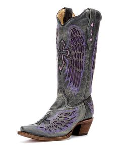 <p>The Corral Women's Distressed Black Winged Cross Purple Inlay snip toe boots feature a black cross with purple inlayed wings on the front and back of the shaft, as well as the toe and heel which allows a statement to be made from all directions! The Inlay boots are made by the finest leather craftsmen in the North American. Genuine leather lines the shaft, insole, and sole for comfort while rubber gripping on the heel and sole provides stability. Get noticed in these special winged cross…