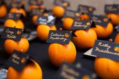 Attach your escort cards to mini pumpkins. Add even more flair with a jack-o'-lantern sticker. Photo Credit: Cary Pennington Photography