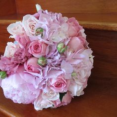 pink peonies with roses, freesias and lisianthus