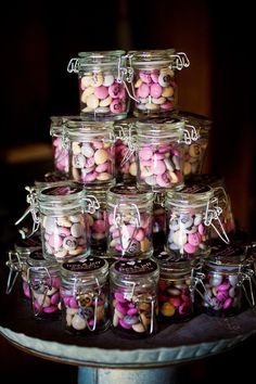 I like the idea of stacking up the favors beautifully by the doors as guests leave instead of them being on the tables