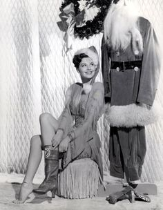 Famous and utterly gorgeous actress Ava Gardner gives us a Christmas Greeting in the 1940's.......Who knew she was Santa Claus??  Or is that a really creepy Mall Santa next to her (even though there were no malls then)??