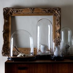 Vintage glass domes by Nixey & Godfrey.