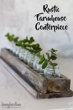 Take a couple of reclaimed boards and build a simple rustic farmhouse centerpiece using some miniature jars and leaf tendrils. Farmhouse Living Room Furniture, Rustic Furniture, Outdoor Furniture, Cheap Furniture, Pallet Furniture, Furniture Ideas, Rustic Kitchen, Rustic Farmhouse, Farmhouse Style
