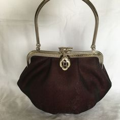 NIB Silk evening bag Brand new in bag, burgundy silk evening bag with single metal handle and accents. Bags Satchels