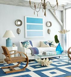Love, love, LOVE this Modern Coastal living room! Lots of beachy accents! But my favorite is THAT rug! I'll take two, please!