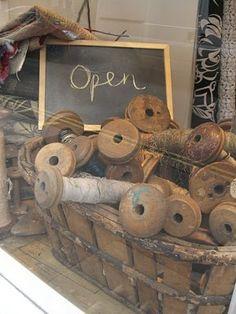Old Basket...filled with olde textile mill bobbins.