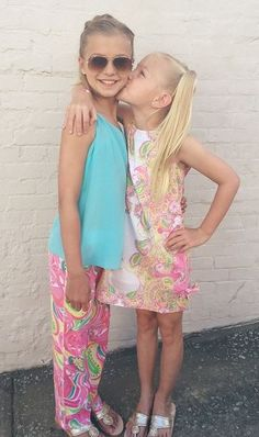 Lilly Pulitzer Girls Little Lilly Classic Shift Dress show in Hotty Pink Double Trouble Engineered Small and the Lilly Pulitzer Girls Plush Little Beach Pant shown in Multi All Nighter via @cloistercollection_athens Istagram.