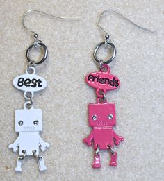 "Handcrafted by Teal Palmetto, LLC. These earrings would make a great gift for your best friend!  Two tiny robots - one enameled in white with the word ""Best"" and the other enameled in pink with the word ""Friends"" - hang from silver-tone jump rings attached to silver-tone fish hook ear wires.  These earrings have a cool feature: the legs on each robot move as the earrings move!  Too cute!  Price: $11"