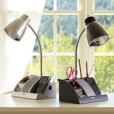 Get Organized Task Lamp | PBteen A little contemporary for my taste, but great small-space solution for a work cubicle to keep ORGANIZED as I like it simple and clean.  Bonus for the iPhone/music dock!