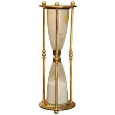 Large brass hourglass/ clessidre ❤ liked on Polyvore