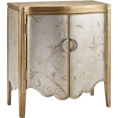 Metallic silver and gold-finished wood cabinet with painted scroll detail and a scalloped apron.    Product: CabinetCons...
