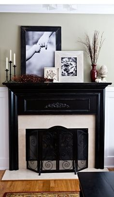 Black Modern Mantlepiece Decor.I like the idea of stacking the photos