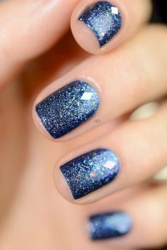 Glitter will make your nails look like a midnight sky