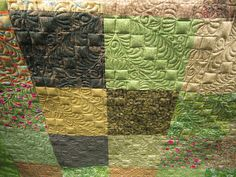 This is the back of the quilt, but you could do this type of quilting on a simply pieced top.  Sue Daurio's Quilting Adventures: Tossed Salad - fresh off the frame