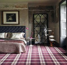 Plaid carpet and rustic walls