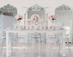 White walls, clear chairs and mirrors. So pretty.