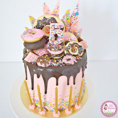 Donut & Sprinkles Birthday Cake - layers of chocolate & funfetti vanilla cake with strawberry swiss meringue buttercream. Decorated with fresh donuts, donut cookies, chocolate donuts, mini chocolate b(Cake Decorating Sprinkles) Donut Birthday Parties, Themed Birthday Cakes, Donut Birthday Cakes, Chocolate Drip Cake Birthday, Chocolate Birthday Cake Decoration, Birthday Drip Cake, Men Birthday, 10th Birthday, Pink Chocolate