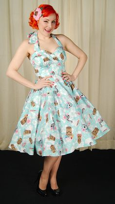 The Suki 50s Tiki Swing dress by Hell Bunny is cute with a touch of creepy! The background is light blue and white hibicus flowers, bones and leaves all over, while the brightly colored skeleton flamingos, flaming skull torches, blue hai...