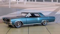 1964 Pontiac Grand Prix | New from Auto World in 1/64 scale.
