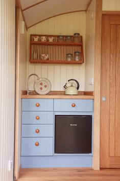 A sneak peek inside a cosy and versatile guest shepherd's hut, complete with a double bed, compact kitchenette and en suite toilet!