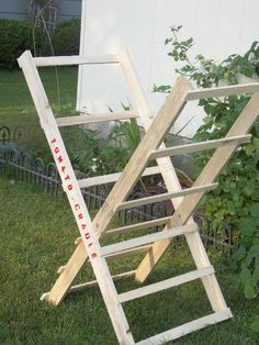 Tomato Cradle, a great invention. Uses furring strips and supports the plant without staking or tying.