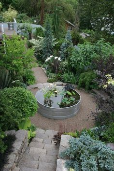 Modern Garden Design Outdoor garden with circular galvanized tub converted into a water feature.Modern Garden Design Outdoor garden with circular galvanized tub converted into a water feature. Garden Paths, Garden Art, Herb Garden, Vegetable Garden, Potager Garden, Big Garden, Lush Garden, Terrace Garden, Shade Garden