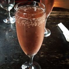 Mimi's Poinsettia, a cocktail made with Sparking wine and cranberry Juice