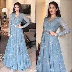 Spotted: looking splendid and classic in a blue draped gown by — a label to look out for! Get this look at Carma via link Indian Gowns Dresses, Pakistani Dresses, Indian Designer Outfits, Designer Gowns, Indian Attire, Indian Outfits, Drape Gowns, Anarkali Dress, Lehenga