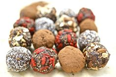 CHOC PRO BALLS 330g Raw Almonds 16 Fresh Dates 2 Tabls Cocoa Powder 1 Tabls Natural Vanilla Extract  1/2 Teas Ground Cinnamon Coconut, Goji Berry, Cacao, or Nuts for Rolling Throw the Almonds into a food processor with Cinnamon, & Cocoa then process until the mix looks crumbly. Add Dates, Vanilla Extract then process again until the mix starts to come together. Add water if you need to so that mixture is soft & forms a soft ball. Roll in coconut & store in the fridge.