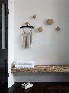Cool decorating tricks for the home.  Varied sizes of wooden knobs used as hooks.  Such a great idea for a bathroom or even entrance area.  Via Bodie and Fou. Photo credit: Carole Whiting who has a lovely shop in Australia http://www.y10store.com and her husband at http://whitingarchitects.com