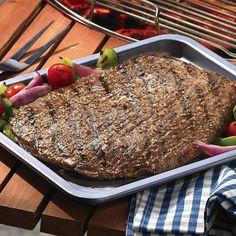 Dele al bistec el sabor ahumado del verdadero mezquite asado con el Grill Mates® Mesquite Marinade (adobo de mezquite).