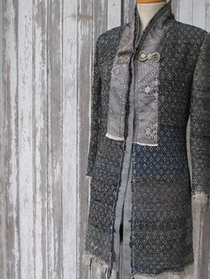 """Long gray coat from Indalia Fashion which features a, """"Unique blend of Italian hand tailoring with Asian and Italian fabrics"""""""