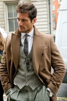 Is it a tweed suit and brown over coat? Gray tweed. I d call it a homie classic English style